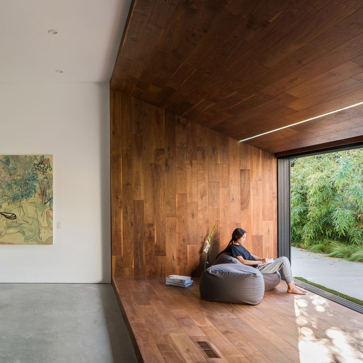 """A Japanese-style reading nook and a sculptural wooden staircase feature in this 1970s Los Angeles house, which has been overhauled by local studio Dan Brunn Architecture to """"pay homage"""" to its original architect Frank Gehry."""