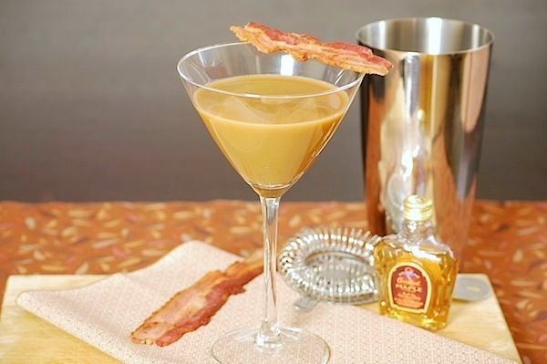 Bacon Coffee Whiskey martini cocktail - breakfast in a glass ;)  4 ounces coffee, room temperature 2 ounces Crown Royal Maple Finished Whiskey 1/2 ounce milk 1/2 teaspoon bacon-flavored syrup (like Torani) Maple syrup 1 strip bacon, fried crisp