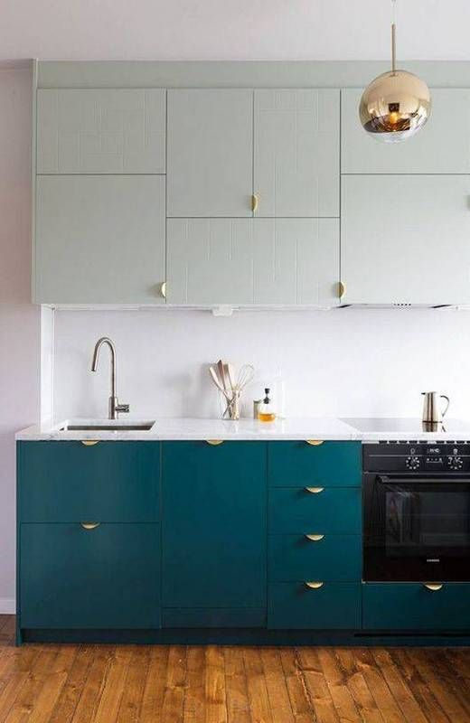 Modern kitchen design ideas: Blue two tone cabinets with gold lighting and ample counter space.
