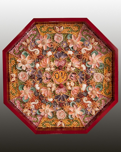 """""""Sailor Valentine"""", seashell mosaic made out under the glass and inside octagonal shadow box."""