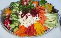 My friends are throwing a party for their club, so they asked me to bring some food. They're all vegetarians and vegans, so I need to prepare something to feed a large group of people that they would like. This seems like a colorful veggie plate that they would like. I can't help but winder what's in the middle of the platter. It kind of seems like there's cauliflower and shreds of beets in the middle.