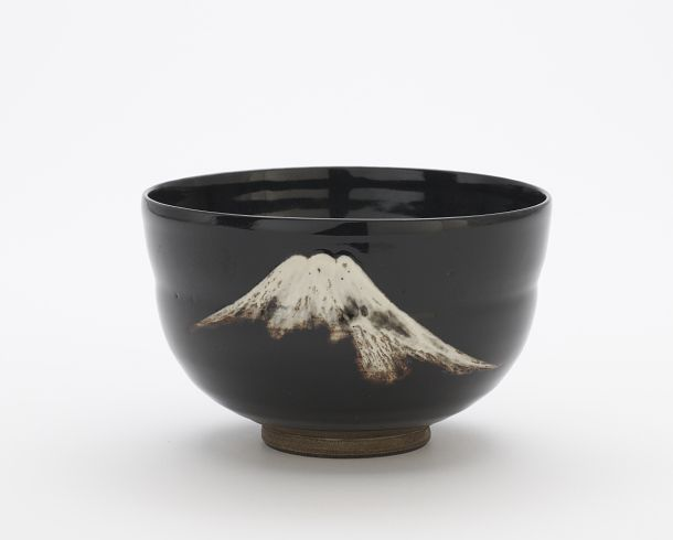 Tea bowl with design of Mt. Fuji  Maker(s)     Artist: Takahashi Dohachi III, IV, or V  Medium:     Stoneware with black glaze and white enamel  Dimensions:     H x W x D: 7.7 x 12.5 x 12.5 cm (3 1/16 x 4 15/16 x 4 15/16 in)  late 19th century