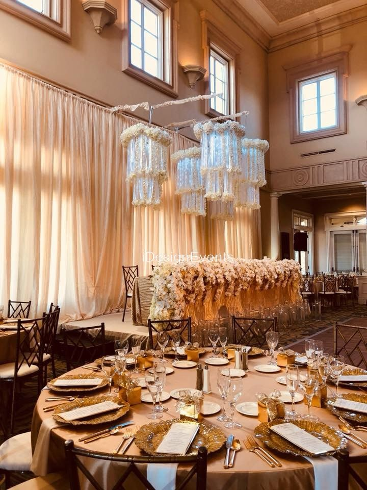 Ruby Hill Gold And White Wedding Decor With Flower Chandeliers With Orchid Garland Of Fresh Flowers Fo Rental Decorating Linen Chair Covers Chair Cover Rentals