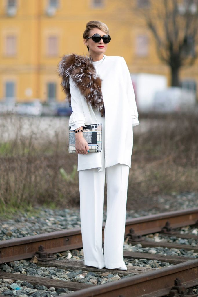A white suit paired with a fur stole.