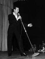 Bobby Darin with a Shure 55.