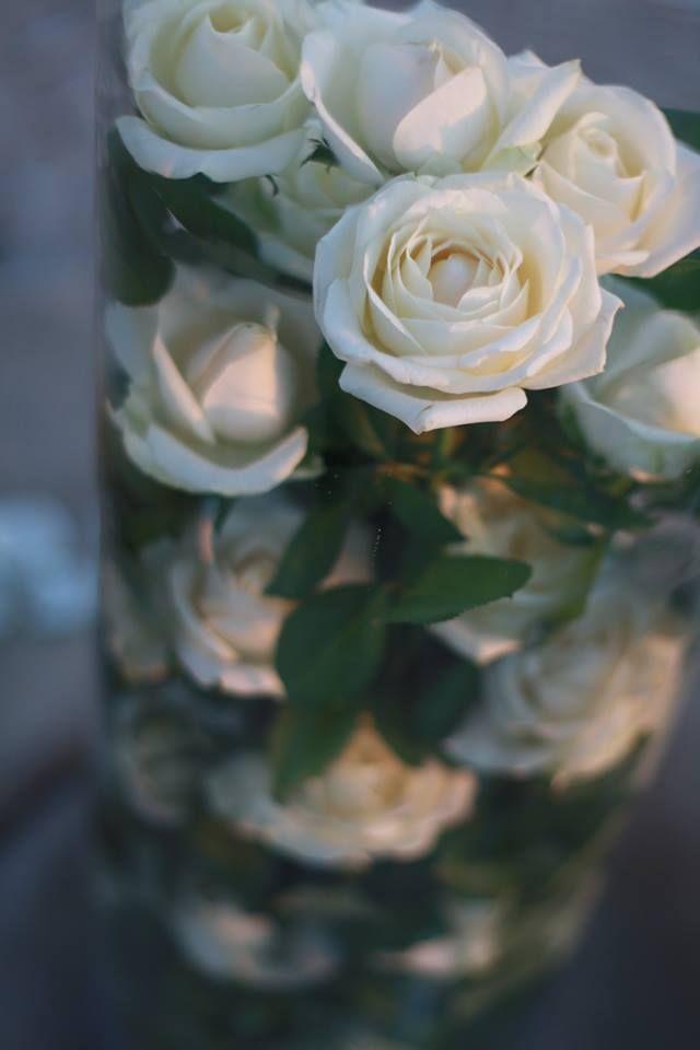 ceremony arrangement , in tall glass vases.