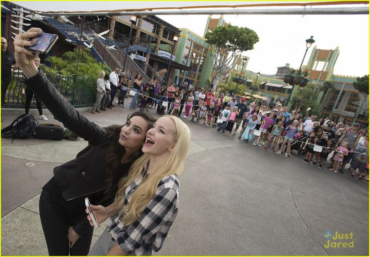 Dove Cameron & Sofia Carson Take Over Downtown Disney For 'Descendants' Fan Event: Photo #880650. Director Kenny Ortega gets in the middle of the Descendants cast for a cute group shot during the Descendants Fan Event held at Downtown Disney at Disneyland on…