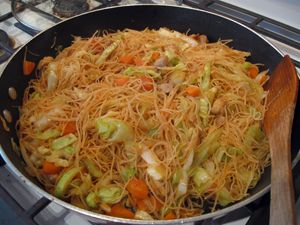 Pancit w/ Chicken. This is delicious, inexpensive and easy to make! It can also be made with leftover pork or chicken. The only thing I did different was soak the rice sticks in chicken bouillon instead of water. I think I will add peapods next time. I made this two nights in a row everyone liked it so much!