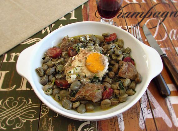 Broad beans with spare ribs and poached eggs | Food From Portugal. A delicious recipe for the whole family, broad beans confectioned with olive oil, onion, bay leaf and garlics, wrapped in chorizo and spare ribs, sprinkled with coriander and served with poached eggs. http://www.foodfromportugal.com/recipe/broad-beans-spare-ribs-poached-eggs/