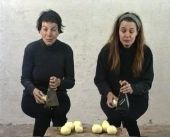 Hanne Nielsen & Brigit Johnsen, Grinding Onions   Lengh: 6:27 min. 1995  Grinding onions shows two women performing in a trivial scene from daily life – grinding onions. The video deals with the collective experience in crying which can be seen as a feminism statement about female circumstances as well as the construction opens up for our collective experience with in crying  and confronts the spectator with suffering as  a concept.