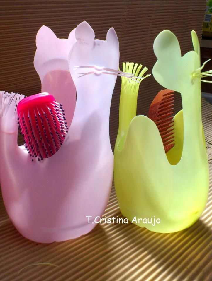 Milk jug hair brush storage containers cut into cat shapes. #diy #MilkJugs
