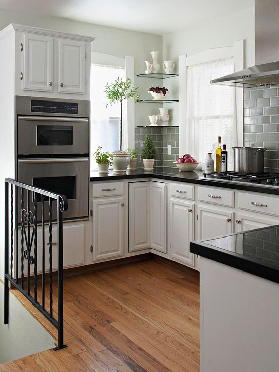 I like the black counter tops and white cabinets. I would do light grey walls and dark grey back splash