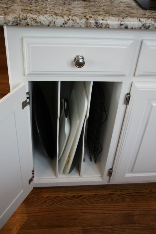 Can you make a spot in the kitchen island for some vertical storage of things like large platters & cutting boards etc?