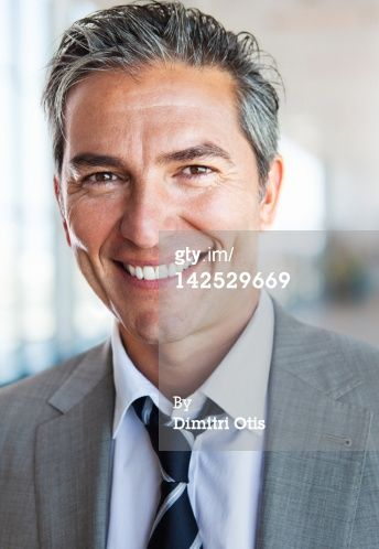 High-Res Stock Photography: Portrait of relaxed casual business man smiling