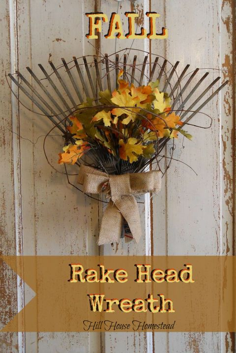 Repurpose an old rake head as a rustic substitution for a traditional wreath by adding a burlap sack bow and faux leaves.