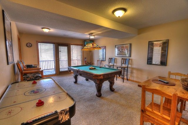 This spacious game room includes air hockey, billiards, plenty of seating and a small bar area and microwave.