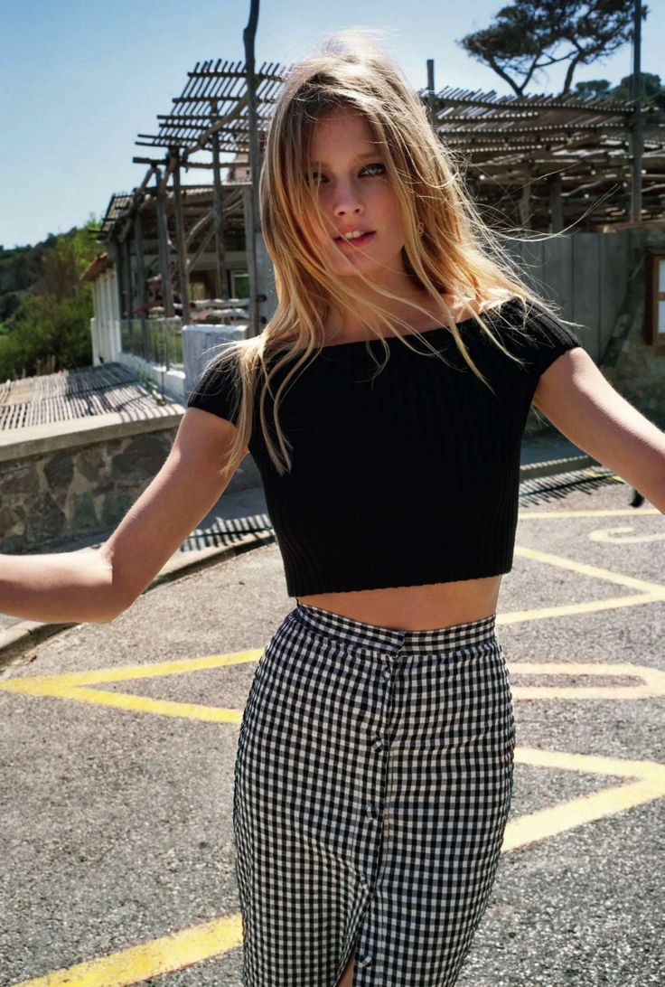 Cropped short sleeve with high waisted gingham skirt.