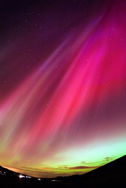 Northern lights...we usually see them in greens and yellows with a bit of blue, but this red is stunning.