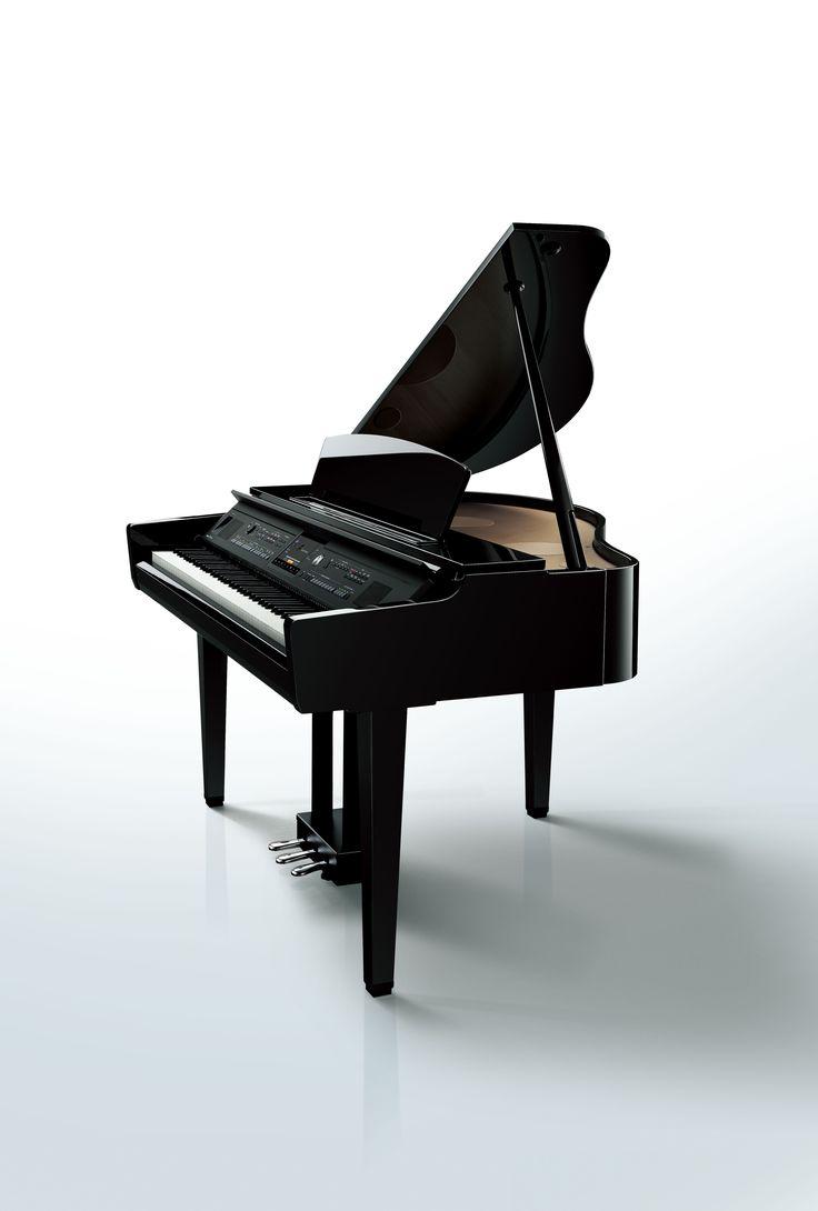 Clavinova CVP-609GP grand-style digital piano in a polished ebony finish.