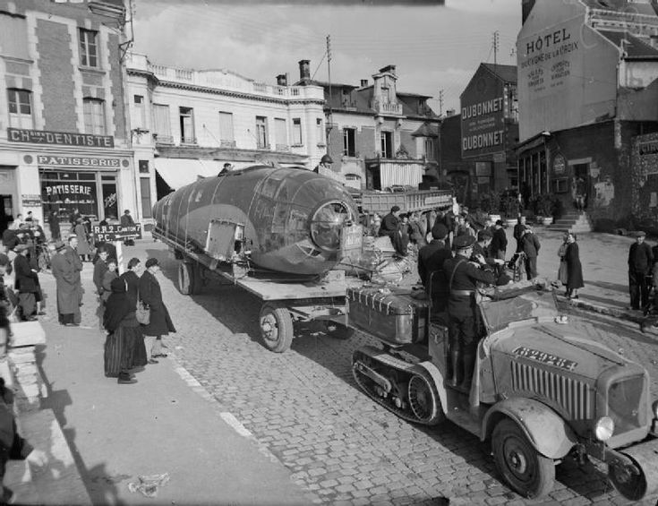 The fuselage of a German Heinkel He111 bomber shot down near Hazebrouck being transported on a trailer through the town of Roye, November 1939.