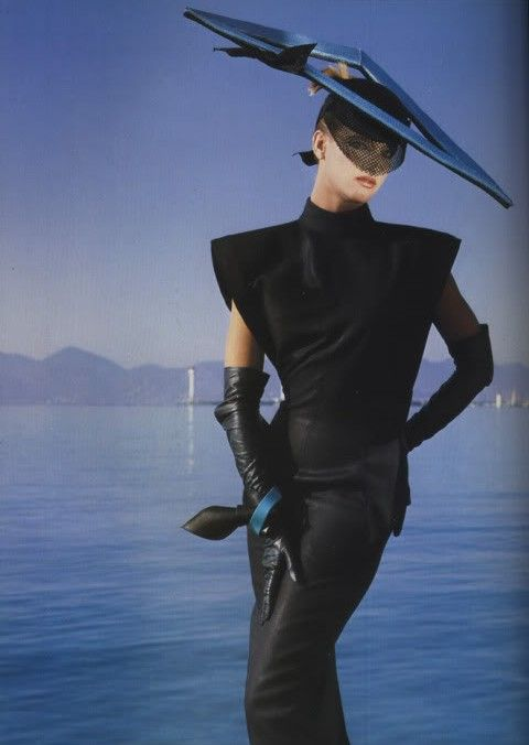 Put the hat on a table, add flowers, enter it in a flower show......Claude Montana, Spring/Summer 1984