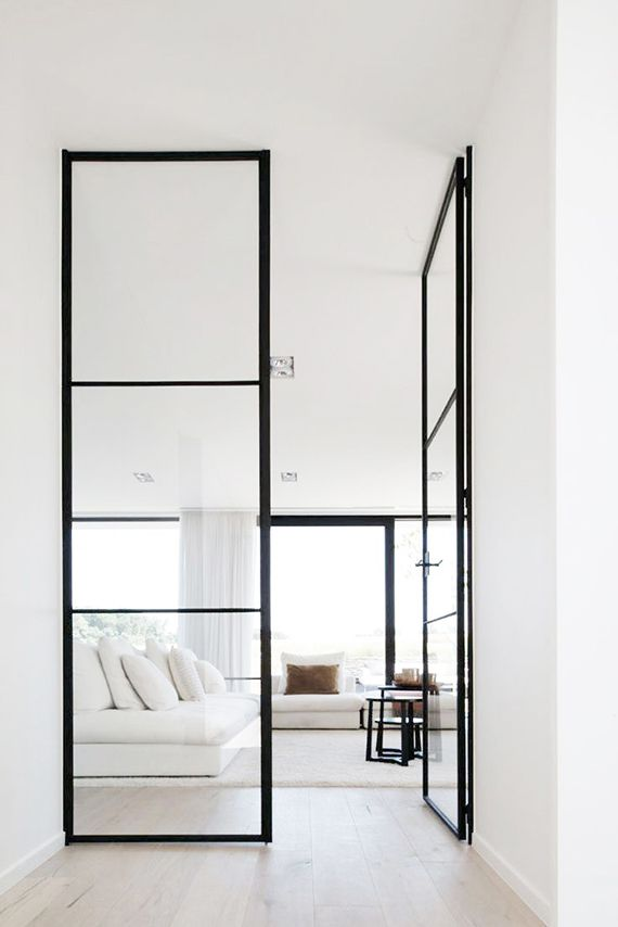 White living room with black metal frame glass doors | Home Sweet Home