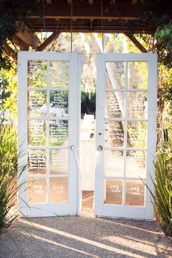 Vintage French doors as seating chart. Photography by camijanephotography.com, Event Design   Planning by dandelionandgrey.com, Floral Design by fleuretica.com