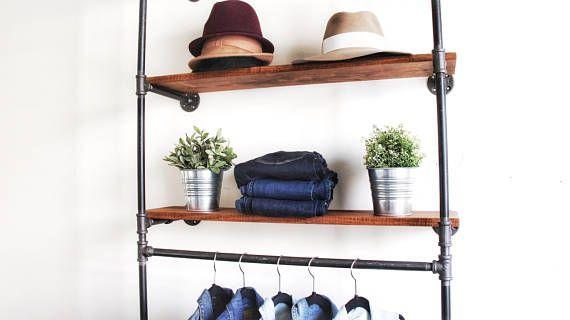 Montado en la pared de la tubería industrial ropa estante