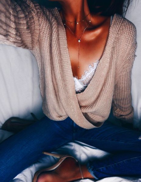 Soft pink sweater with a white lace bandeau                                                                                                                                                                                 More
