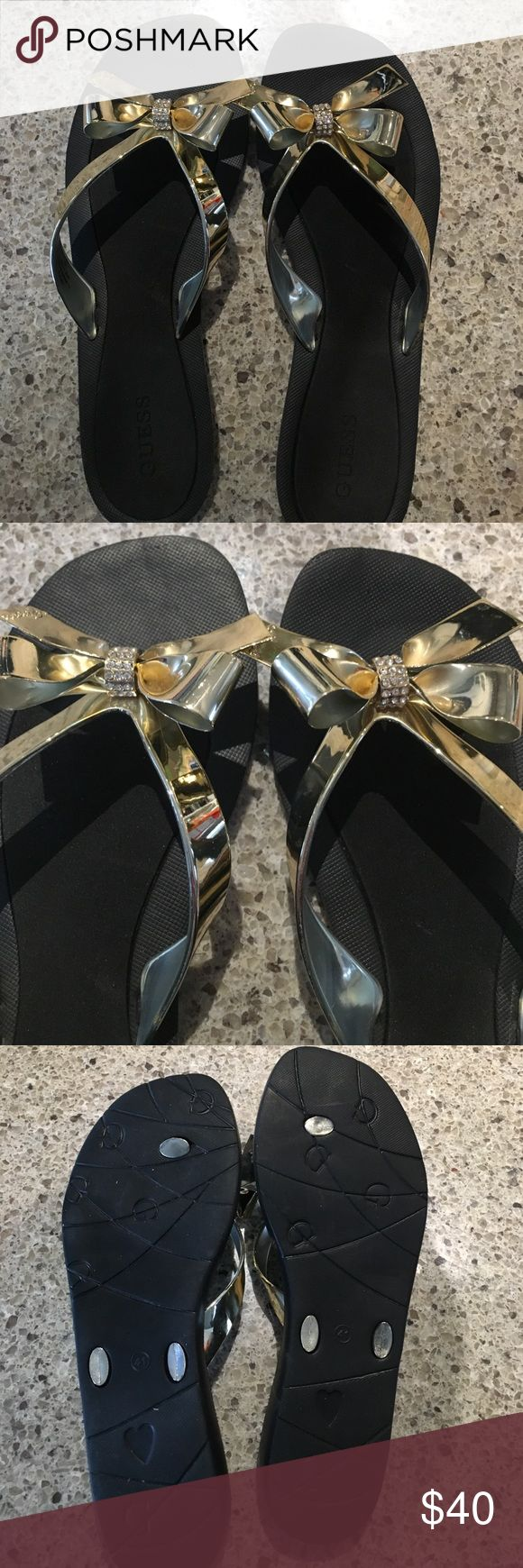Guess ladies gold bow flip flop sandals NWOT ladies gold bow flip flops.  Worn once.  Guess brand.  No trades/no holds.  Size says (41 ) or an 11.  Personally they are more like a 10 in ladies Guess Shoes Sandals