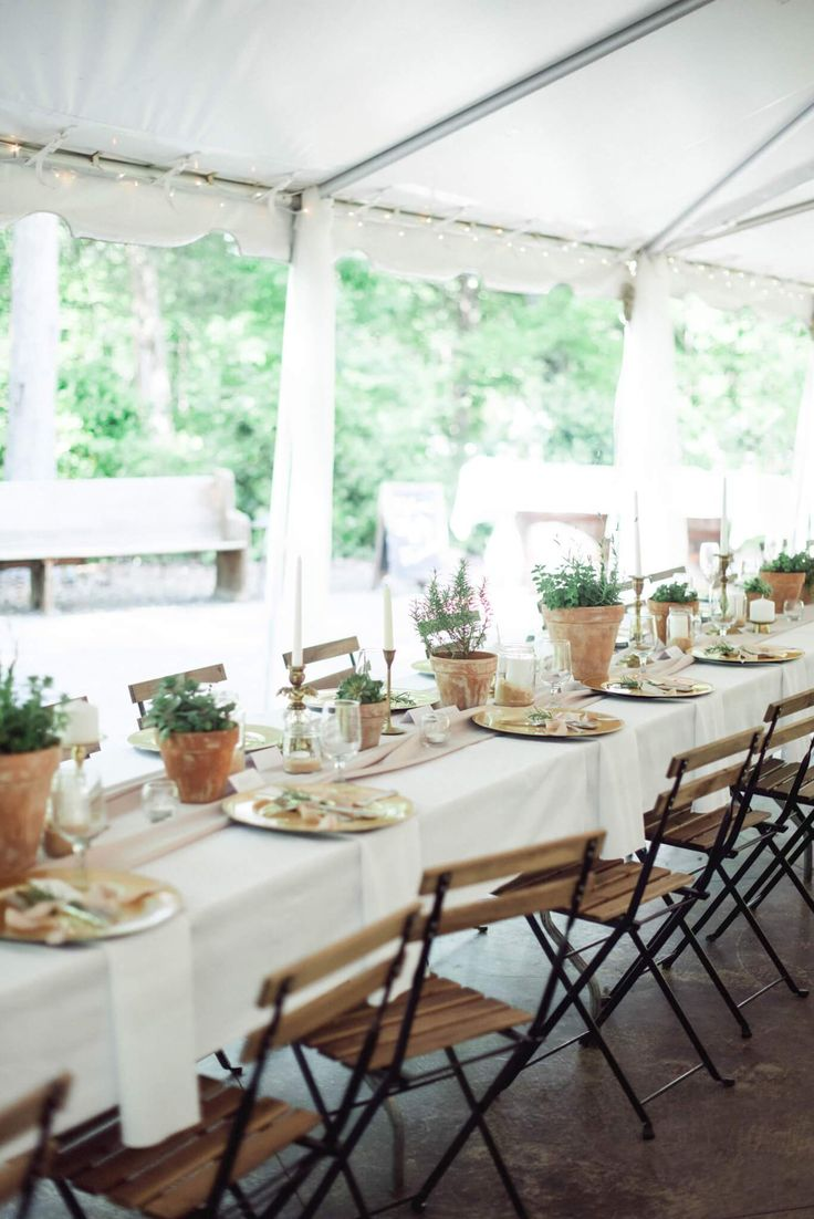 Coralandcharm.com spring wedding, long sleeve lace and open back wedding dress, Tuscan garden outside ceremony, glam makeup, sleek updo, organic full greenery bouquet, taupe and neutral bridesmaid dresses, distressed pots with succulents and gold accents, bride and groom photos