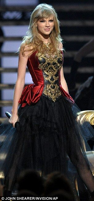 I am so in love with Taylor Swift's dress during her performance at the AMA's. Best performance ever! :)