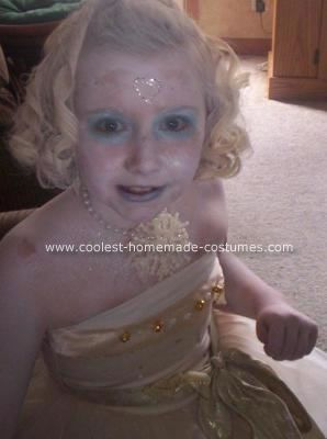 Homemade Ice Princess Costume: I thought of this homemade ice princess costume idea from the movie Narnia. I bought white hair paint and sprayed my daughter's whole body with it. I took