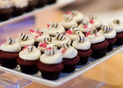 Delicate chocolate curls topped miniature cupcakes #royalcaribbean