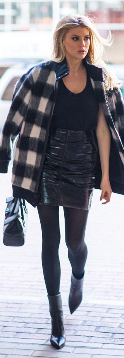 Charlotte McKinney: Jacket – Designers Remix  Purse – Versace  Skirt – Maje