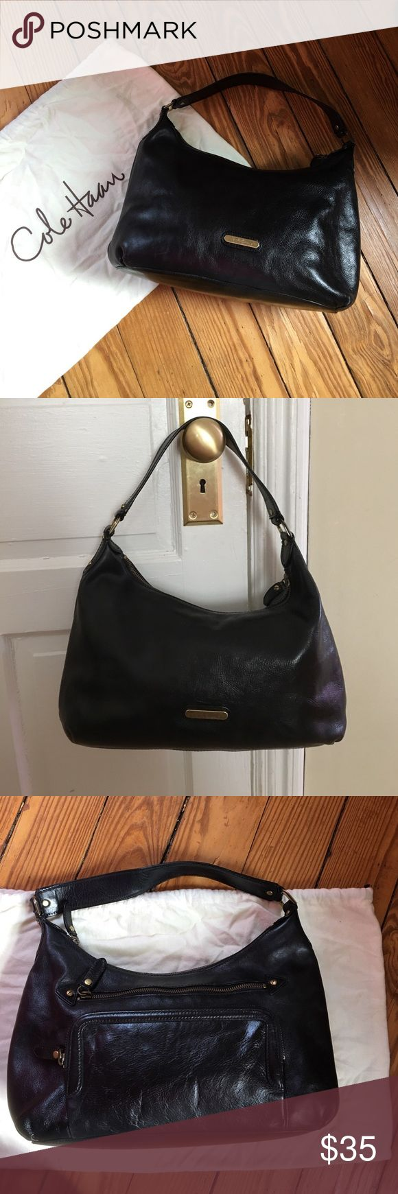 Cole Haan Black Leather Bag Purse Black leather bag with brass accents by Cole Haan. Measures 9 x 13 inches. Brass logo plate has some tarnish, but that only adds to the vintagey look of the bag. Minor wear on bottom/corners, but overall very good condition. Comes with dust bag. Cole Haan Bags Shoulder Bags