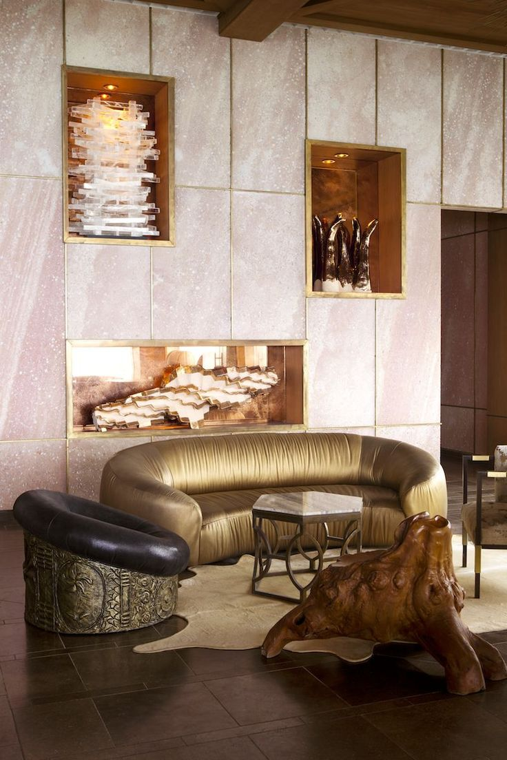 Statement furniture and custom carve-outs for artwork bring focus to a hotel lobby. Kelly Wearstler Commercial.