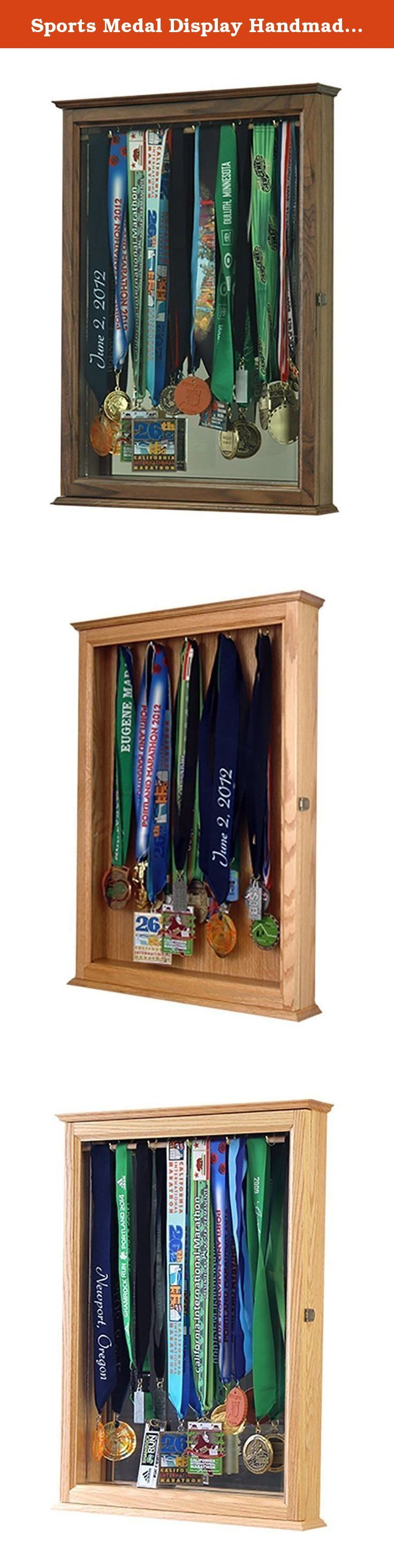Sports Medal Display Handmade Out Of Solid Walnut in the USA. You will find many products available on-line for hanging medals, but none of them are made with the care and quality of this cabinet which is made in our Oregon workshop. This is the ultimate complement to the athlete's accomplishments! Constructed of solid Walnut hardwood with a glass door to protect contents. Finisher medals hang from 5 hooks. Cabinet comes equipped with brass door hinges and a high quality door latch. It is...