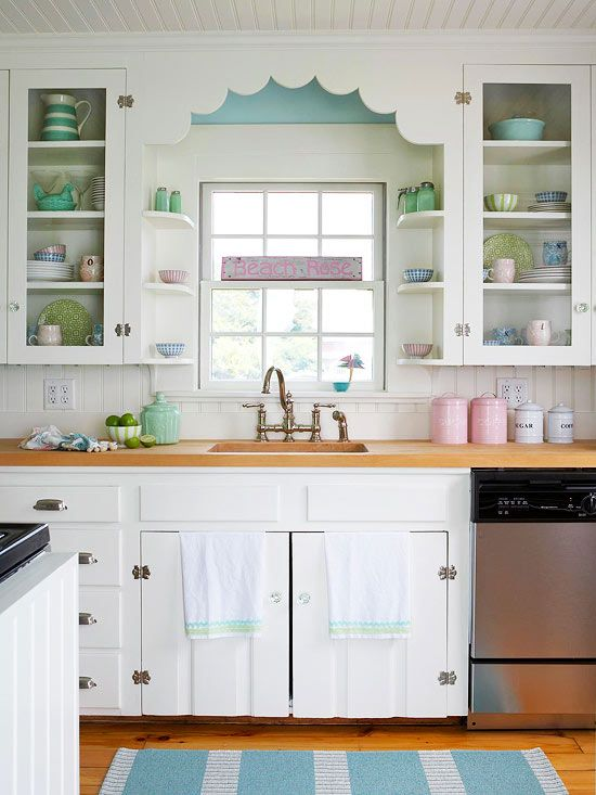Vintage-inspired hardware and sweet pastels give this kitchen charming cottage style. More kitchen cabinets: http://www.bhg.com/kitchen/cabinets/styles/kitchen-cabinets-in-white/?socsrc=bhgpincottagewhite&page=6