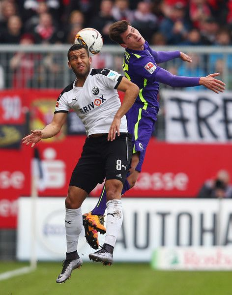 Pascal Stenzel Photos Photos - Andrew Wooten (L) of Sandhausen jumps for a header with Pascal Stenzel of Freiburg during the Second Bundesliga match between SV Sandhausen and SC Freiburg at Hardtwaldstadion on February 21, 2016 in Sandhausen, Germany. - SV Sandhausen v SC Freiburg - 2. Bundesliga