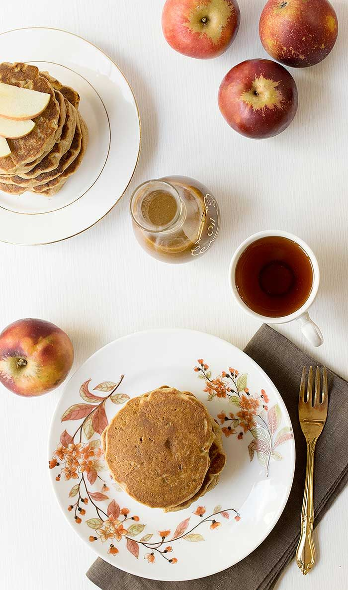 Gluten-free Apple Teff Pancakes with Homemade Date Caramel Syrup that are perfect on a fall day or for breakfast Christmas morning!