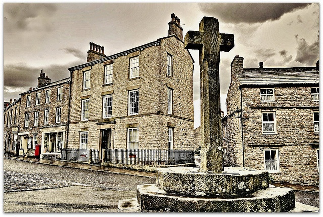 """Askrigg ~ Wensleydale the fictional Darrowby in the BBC TV series All Creatures Great and Small. The large three story building was the vets' home, """"Skeldale House"""" ."""