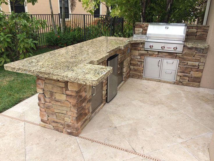 Custom Delta Heat Outdoor Kitchen With Refrigerator Rock Finish And Granite Top
