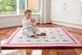 $149.95    Little Birdy Kush-ee® Mat /    This is one playmat that will not ruffle any feathers!     The Little Birdy Kush-ee® Mat is simply divine - the soft pinks and reds ooze girliness, topped off with a savvy design that will compliment any play area.  These playmats are not only soft-cushioning, but portable too - so comfort & style can go wherever your baby does!