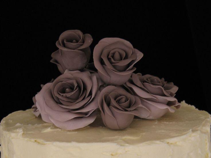 Purplish grey roses.