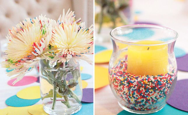 """21. Confetti Centerpieces: Add a """"confetti"""" of colors to white flowers by drawing colorful dots on the petals. Put candles in clear vases and fill them with sprinkles for a confetti-inspired twist."""