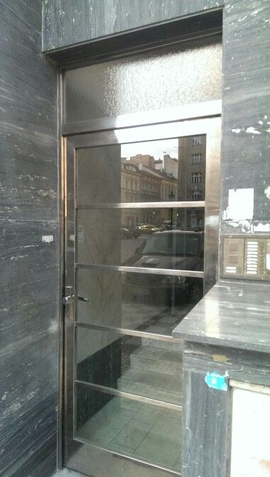 Chrome entrance door with marble panelling 1930s Prague