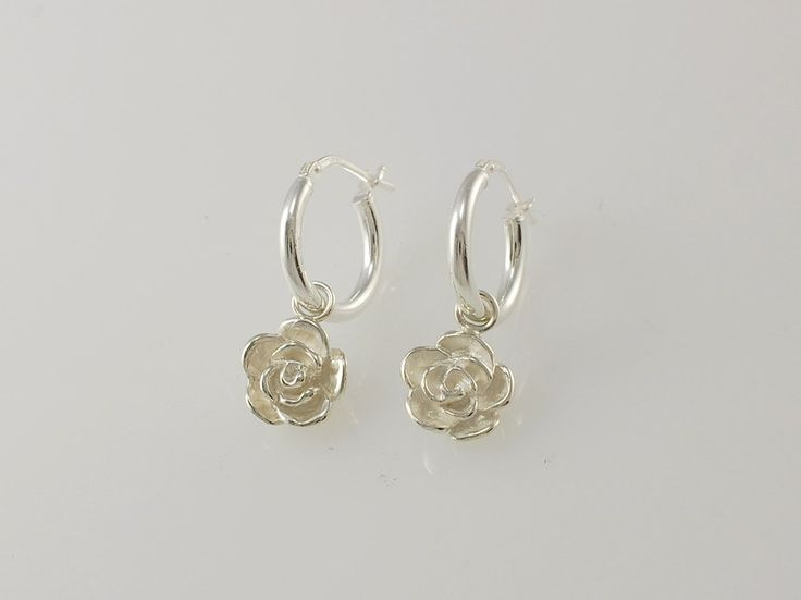 "-Rose Hoop Earrings- NZ$119- Silver. Give the gift of everlasting love with our silver Rose drop earrings, they will never wilt and are sure to last a lifetime! For centuries the rose is has been a symbol of ""Love"". The tradition of giving flowers dates back to the ancient Greeks and has been elaborated by the Victorians to giving entire bouquets. Range also includes hoop earrings, and pendants. Rose size 9.5mm, hoop size 14mm. Jewellery made @jewelbeetle in Nelson, New Zealand."