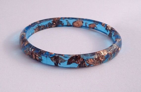 Handmade faceted eco-resin bangle in marine blue with copper leaf.