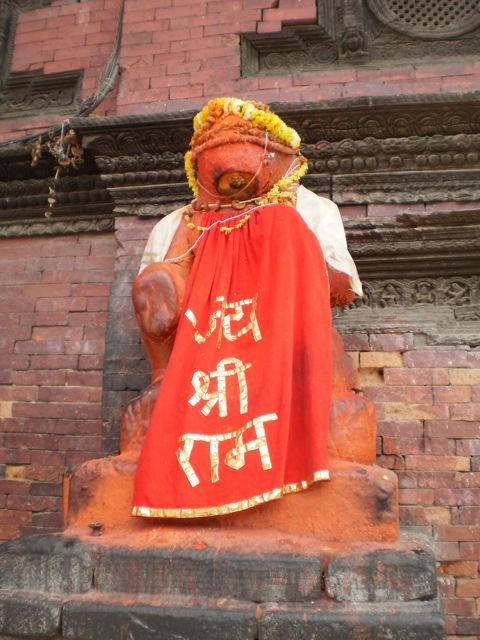 A god in his finery in Durbar Square, Patan
